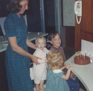 Wanda holding sister, Jerrie (1), Karen (2) on Mark's 11th birthday