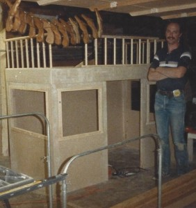 1988, Mark building a bed for Katie's 4th birthday. The bunk bed sat on top of a playhouse.