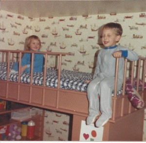 1987, Katie and Christopher sitting on the bed their Dad built.