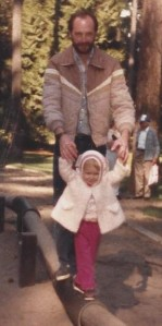 1986 - Katie teaching her dad how to walk on the beam.