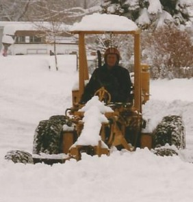 Dad shoveling snow